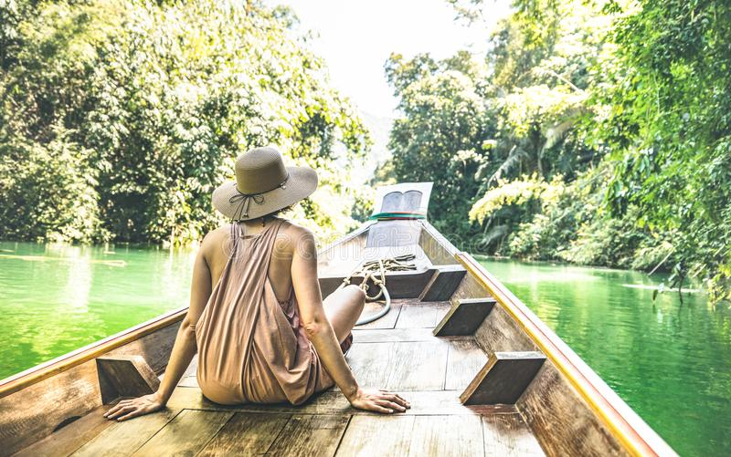 Young woman traveler on longtail boat trip at island hopping tour stock photo