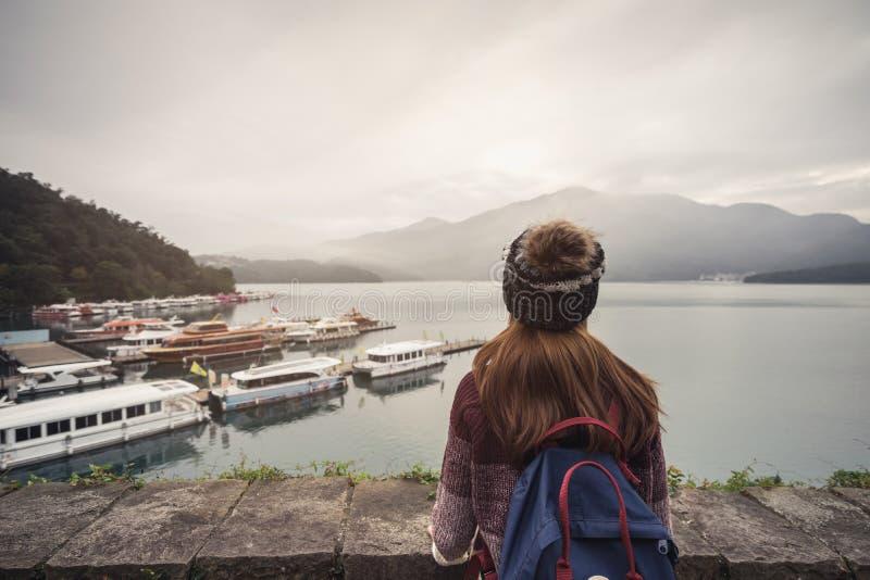 Young woman traveler looking a beautiful view at sun moon lake stock photography