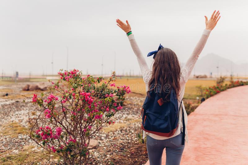 Young woman traveler opens arms and feeling happy going sightseeing in Egypt. Girl walking on excursion. Traveling concept royalty free stock photos