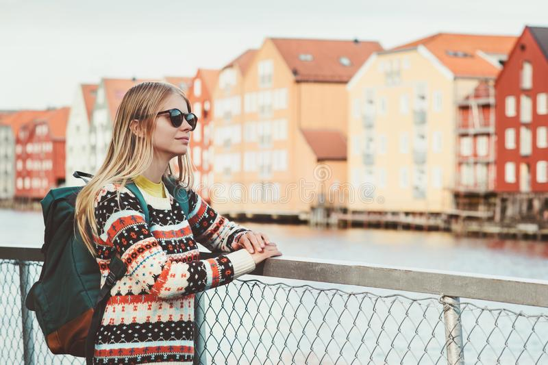 Young woman traveling in Trondheim city Norway vacations weekend Lifestyle fashion outdoor scandinavian houses landmarks architect. Ure on background stock photography