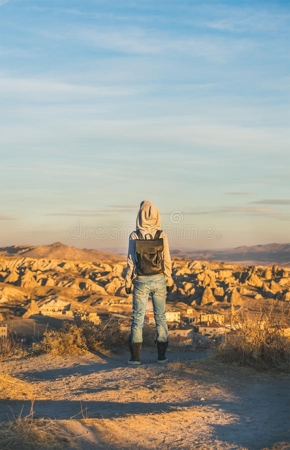 Young woman traveller standing and watching sunrise, Cappadocia, Central Turkey royalty free stock images