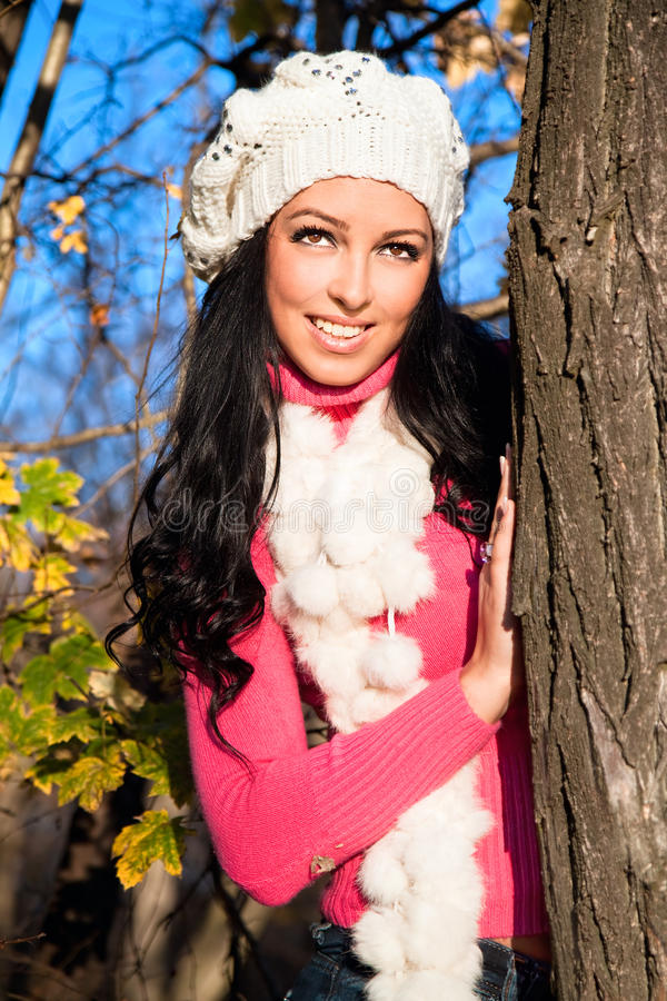 Download Young Woman On Tree Enjoying Autumn Fall Season Stock Photo - Image: 21750276