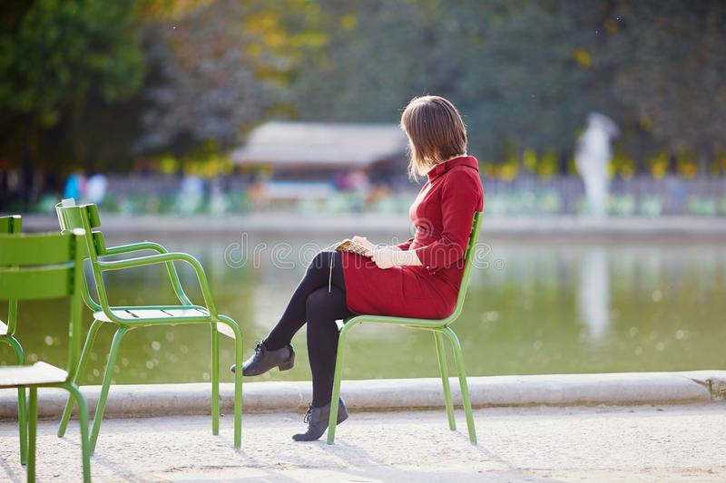 Young woman in Tuileries garden of Paris, France royalty free stock photography