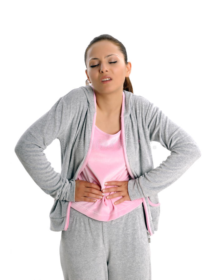 Young woman with tummyache. Woman holding her stomach with her hands. attractive young women tummyache royalty free stock photography