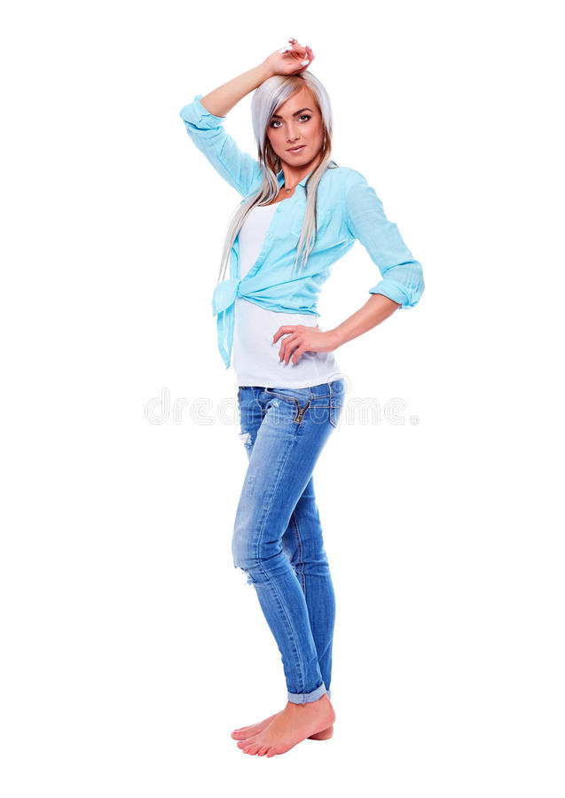 Young woman in a turquoise shirt with bare feet royalty free stock photos