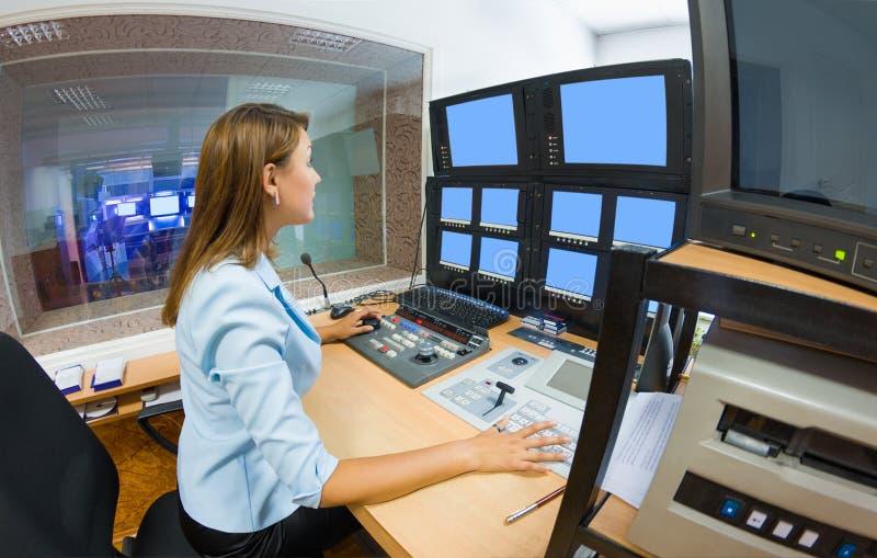Young woman TV director at editor royalty free stock photo