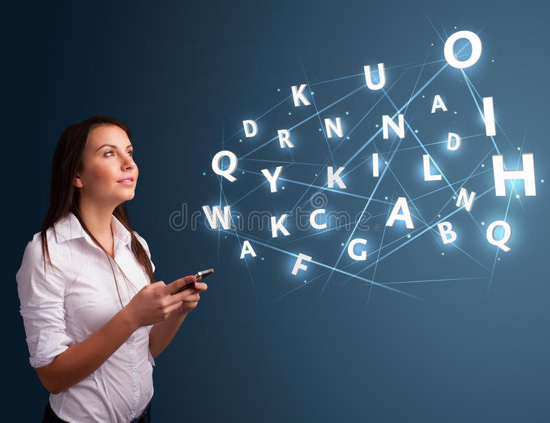 Young woman typing on smartphone with high tech 3d letters comming out royalty free stock photos