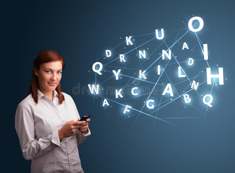 Young woman typing on smartphone with high tech 3d letters commi stock photography