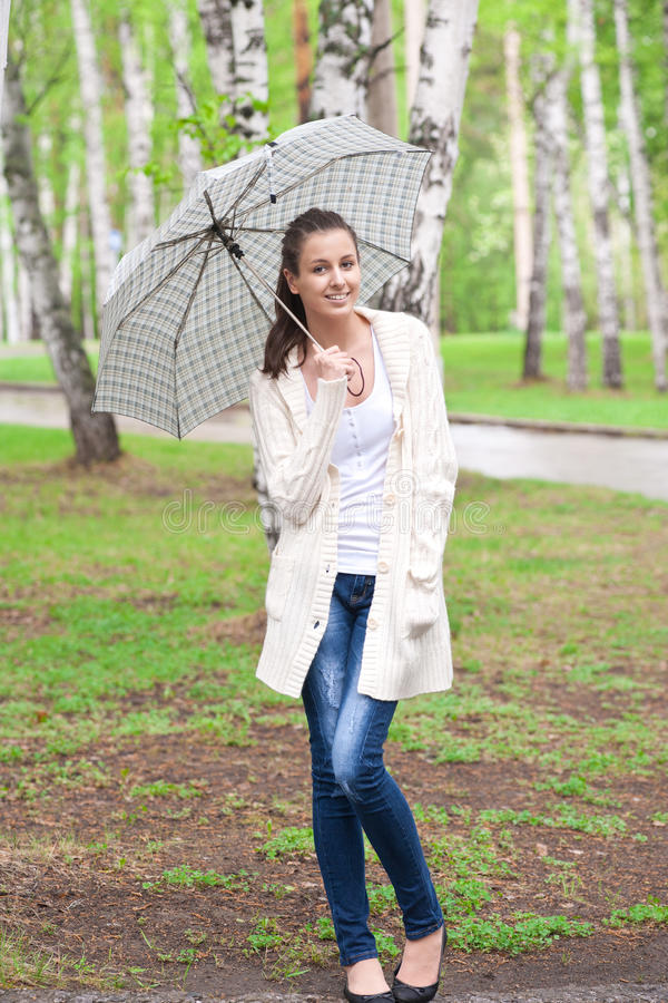 Young woman with umbrella royalty free stock image