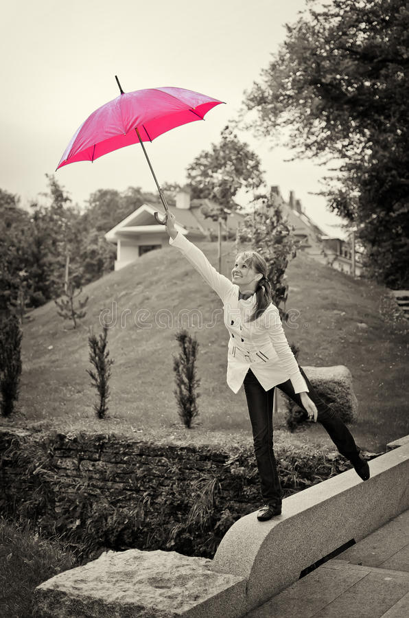 Download Young woman with umbrella stock photo. Image of freedom - 26516912