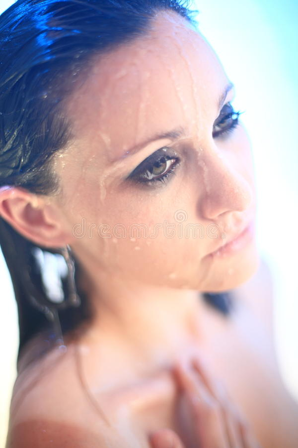 Young Woman Under Shower Spray Royalty Free Stock Photography