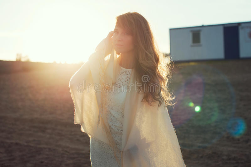 Young woman under sunset light, outdoors portrait. Soft light and Sunshine royalty free stock images