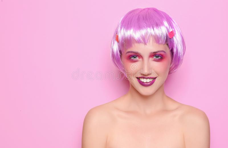 Young woman with unusual hair and professional makeup on color background royalty free stock photos