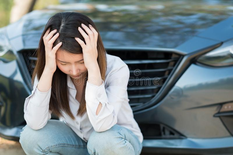Young woman upsets with her broken down car stock photography