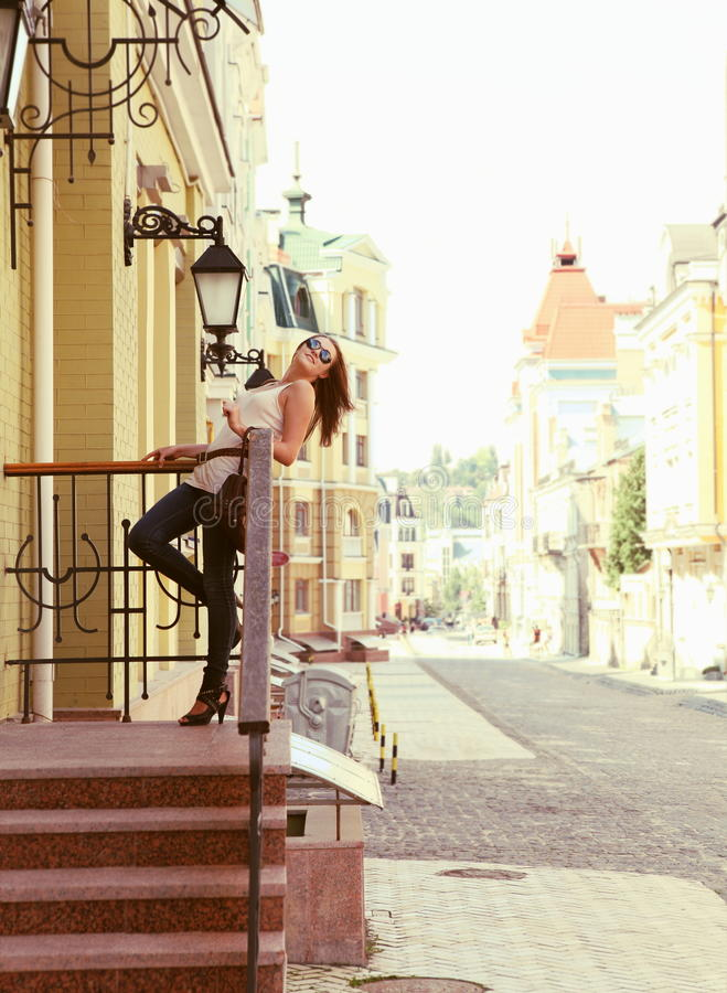 Download Young Woman Upstairs Posing Outdoors Stock Image - Image: 26477105