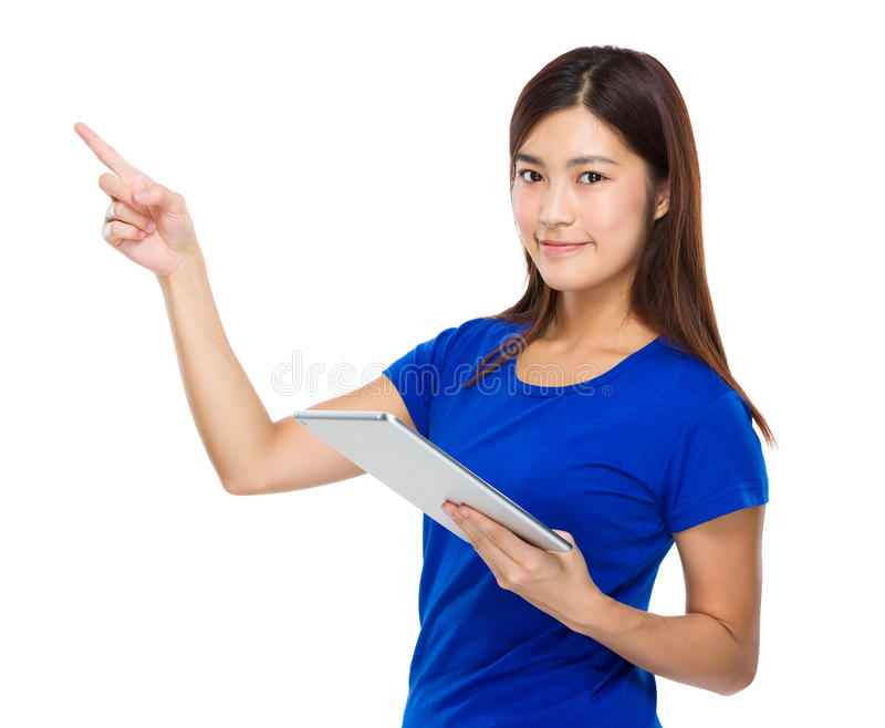 Young woman use of the tablet and finger point up stock images