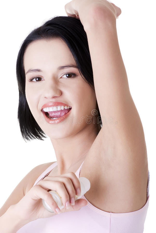 Download Young Woman Using Antiperspirant Stock Image - Image: 26461005