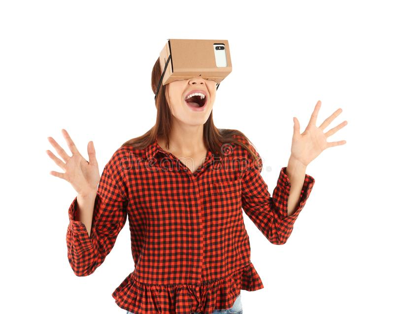 Young woman using cardboard virtual reality headset royalty free stock image