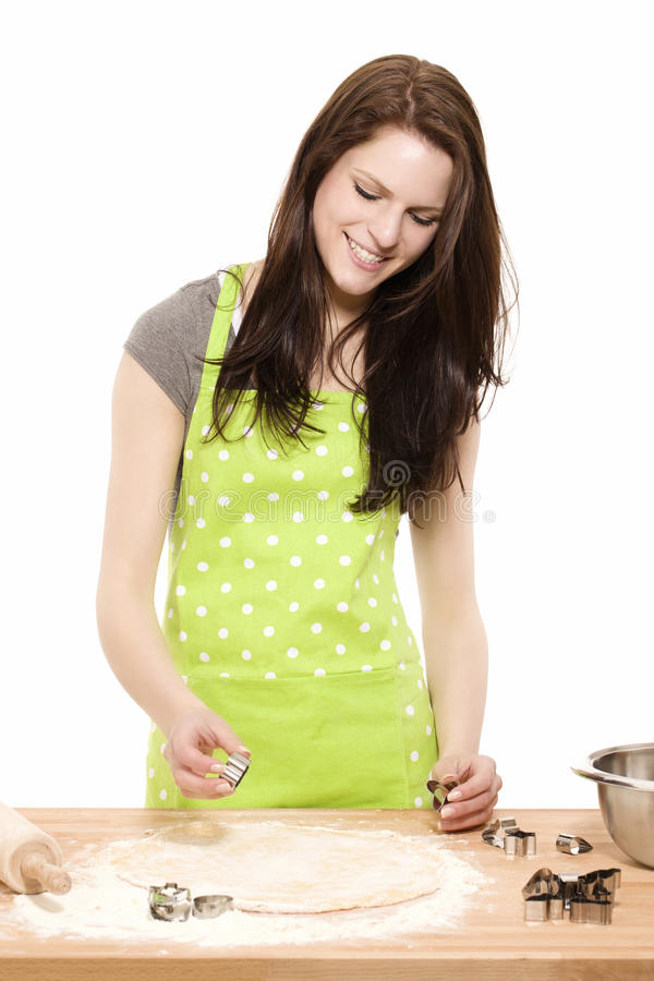 Young woman using christmas molds stock images