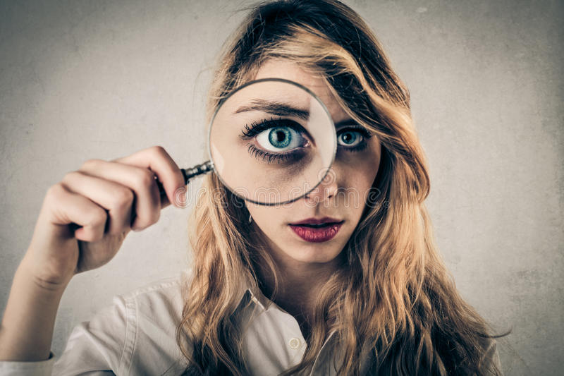 Download Young Woman Using A Hand Lens Stock Image - Image of pretty, concerned: 39502833