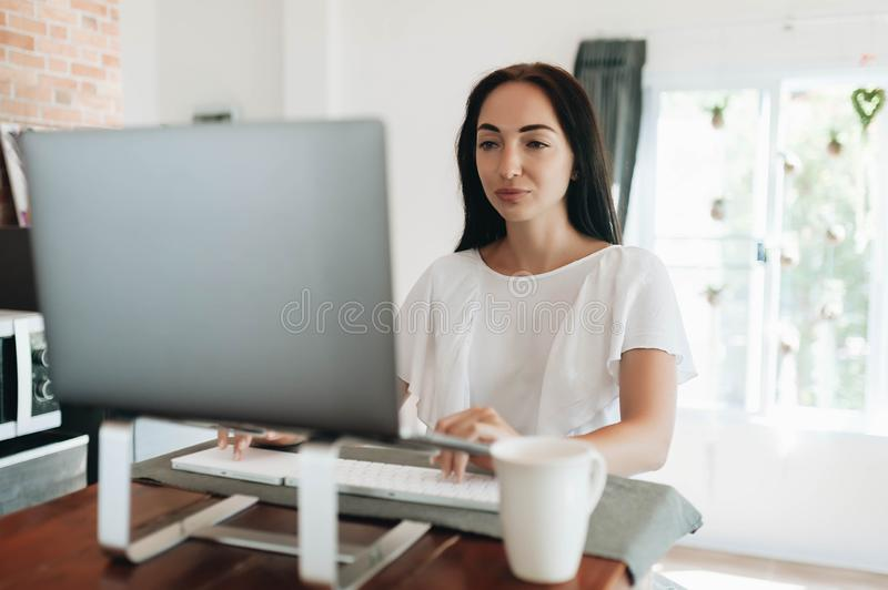 Young woman using her laptop at home royalty free stock photography