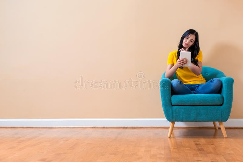 Young woman using her tablet royalty free stock images
