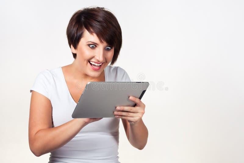 Young woman using iPad stock photos