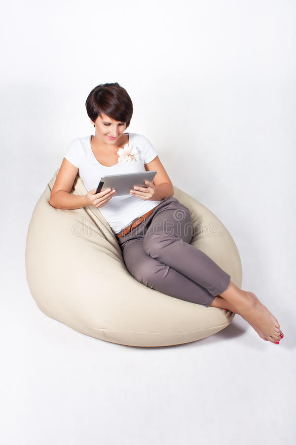 Download Young woman using iPad stock photo. Image of rest, reading - 21453792
