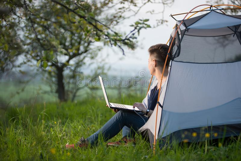 Young woman using laptop outdoors stock images