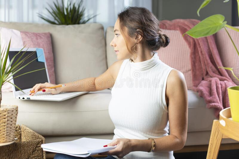 Young woman using laptop on sofa royalty free stock photo