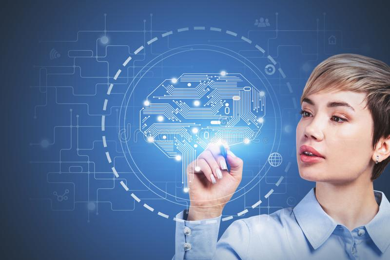 Young woman using machine learning interface. Beautiful young computer scientist working with immersive futuristic machine learning interface. Concept of hi tech royalty free stock photos