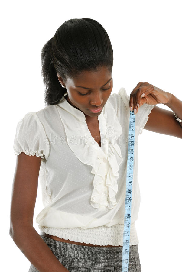Young woman using measuring tape stock photo