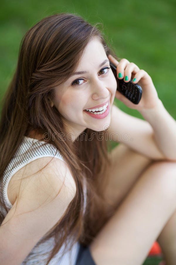 Download Young Woman Using Mobile Phone Stock Photo - Image: 24929048