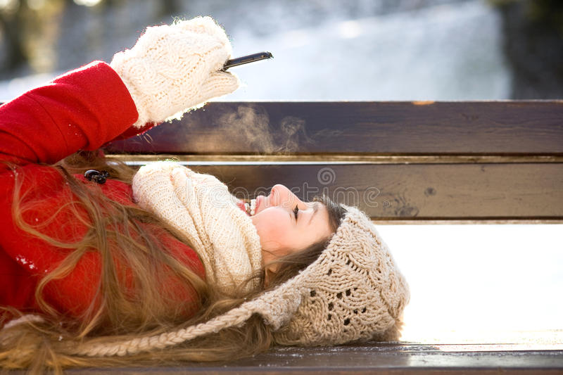 Young Woman Using Mobile Phone Outdoors Stock Images