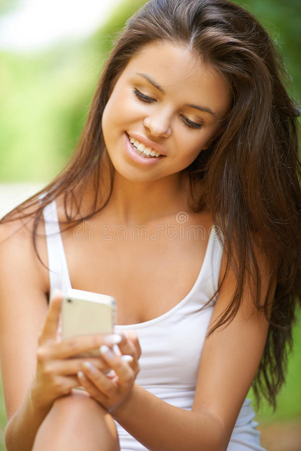 Download Young Woman Using Mobile Phone Stock Photo - Image: 33034964