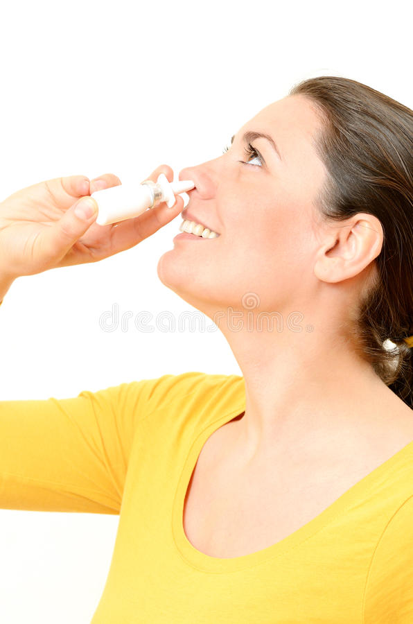 Download Young Woman Using Nasal Spray Stock Image - Image: 30340557