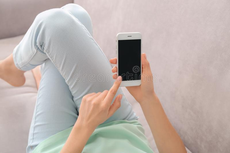 Young woman using phone at home stock photos