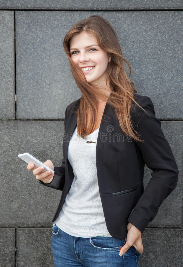Young woman using smartphone stock photography