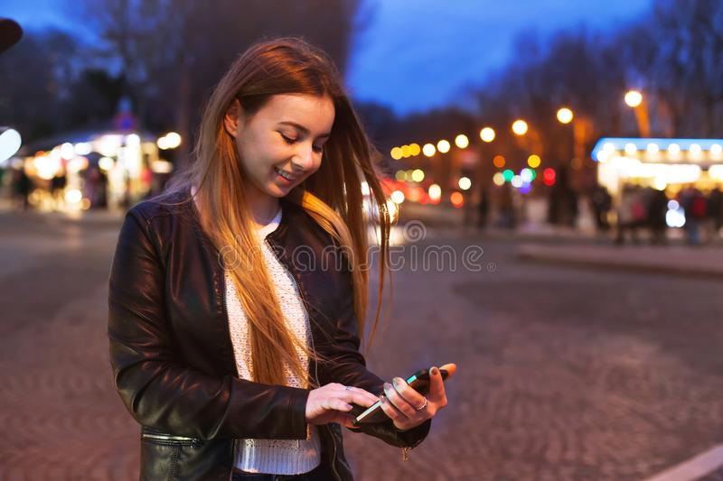 Young woman using smartphone on the street royalty free stock images