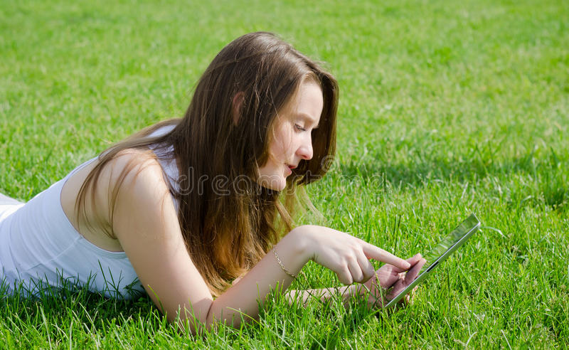 Young Woman Using Tablet Notebook Stock Photos