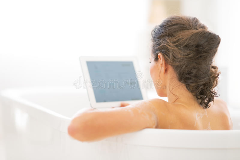 Download Young Woman Using Tablet Pc In Bathtub. Rear View Stock Photo - Image: 41761990