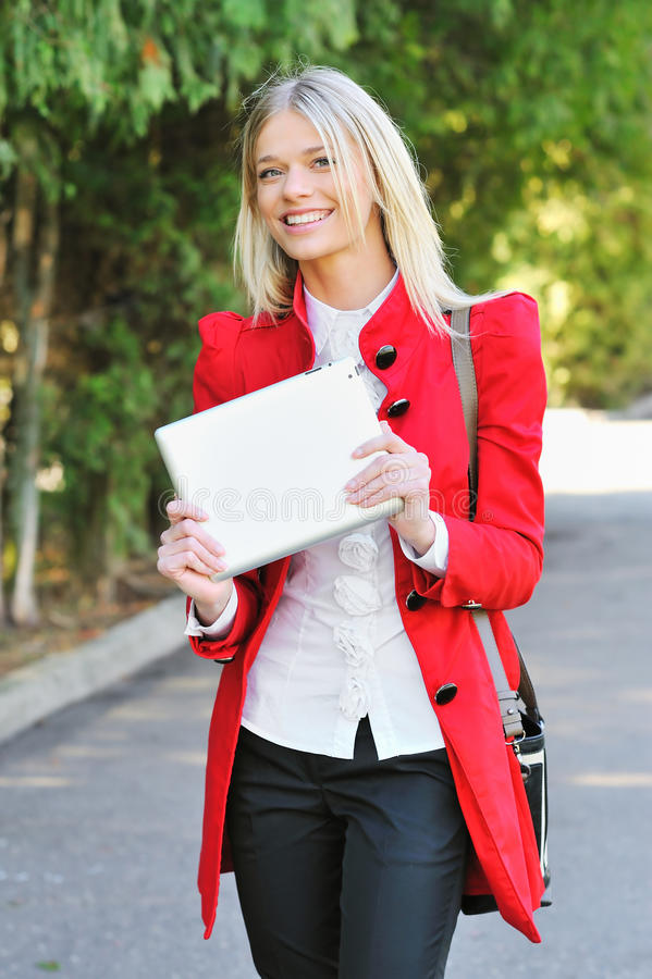 Young Woman Using Tablet PC Outdoors Stock Photo