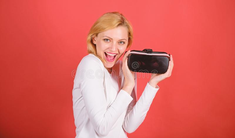 Young woman using a virtual reality headset with conceptual network lines. Woman using virtual reality headset. A person. In virtual glasses flies in room space stock photo