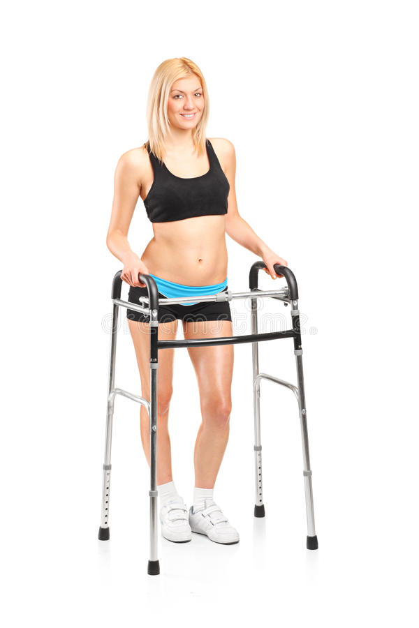 A young woman using a walker