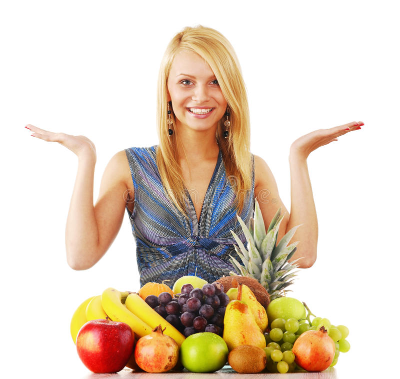 Young woman with variety of fruits stock photos