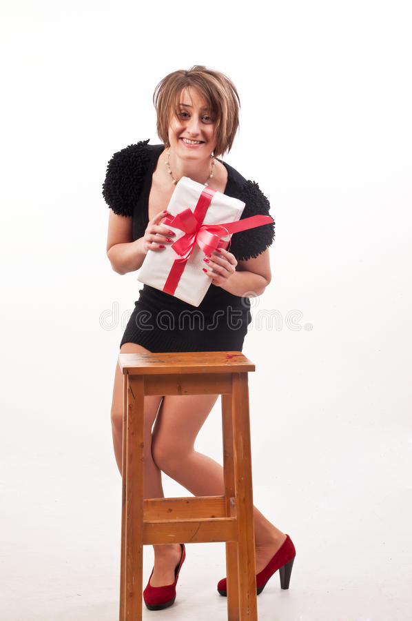 Young woman very happy for the gift that she just received stock photography