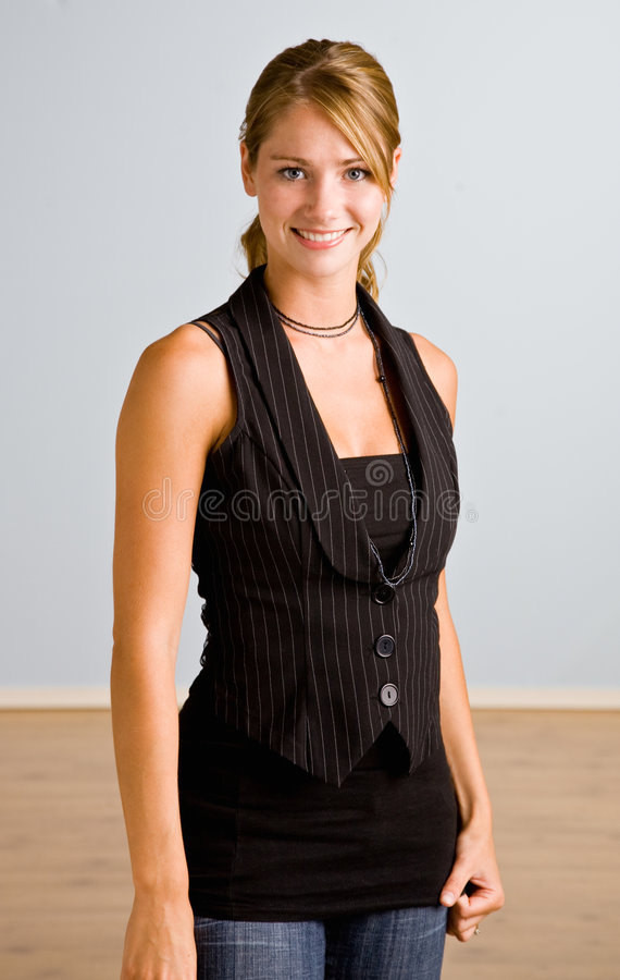 Young Woman In Vest Smiling Stock Photos