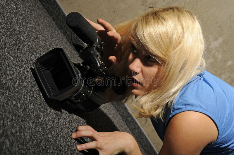 Young woman video camera stock photography