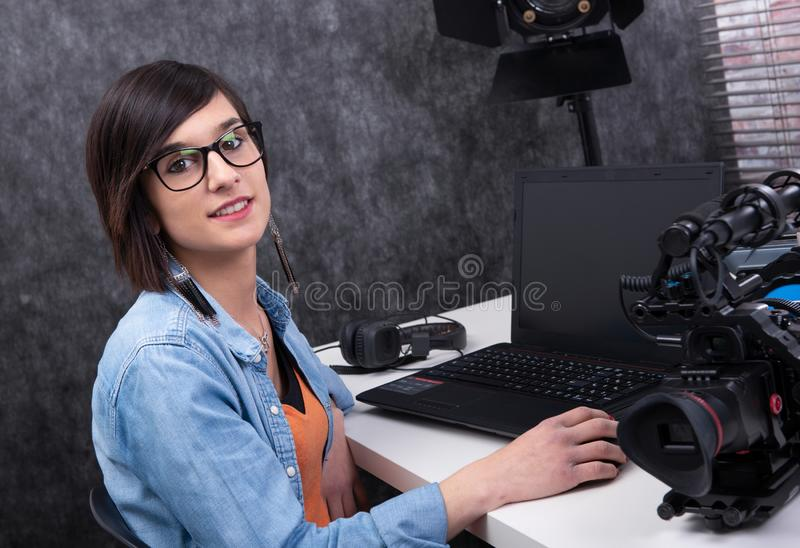 Young woman video editor working in studio royalty free stock photo