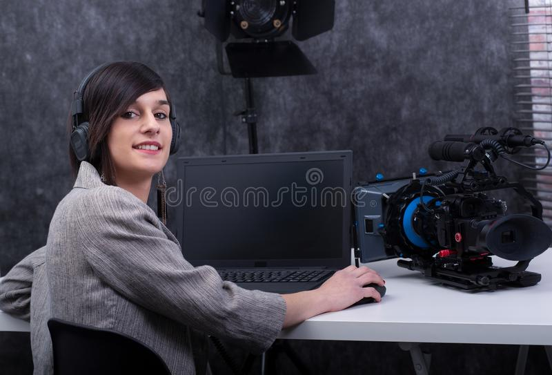Young woman video editor working in studio stock photo
